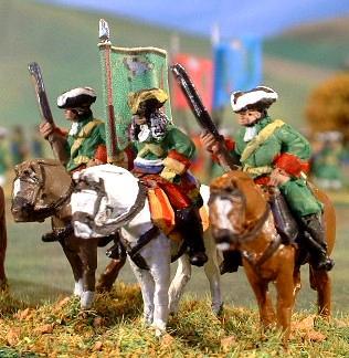 MA9 Dragoon Trooper with firearm, MA15 Cavalry Officer guidon bearer, MA9 (again).